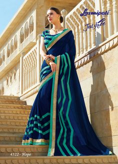 Buy this Eye Catchy Navy Blue & Green Chiffon Saree and Navy Blue, Green Blouse along with Satin Silk Patta, Fancy Lace Border online from Laxmipati.com in USA, UK, Canada and India. Shop Now!  #Catalogue- #JAISHREE #DesignNumber: 4522 #Price - ₹ 3492.00 #Bridal #ReadyToWear #Wedding #Apparel #Art #Autumn #Black #Border #MakeInIndia #CasualSarees #Clothing #ColoursOfIndia #Couture #Designer #Designersarees #Dress #Dubaifashion #Eco Laxmipati Sarees, Lehenga Saree, Saree Dress, Indian Sarees, Sari, Fancy Sarees, Party Wear Sarees, Indian Outfits, Indian Clothes