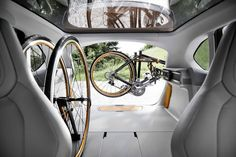 The carrier holds bikes for transport and maintenance thanks to a pivoting arm .... BMW built in bike rack !