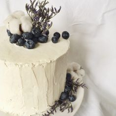 Blueberry blue velvet cream cheese cake decorated with cotton and flowers
