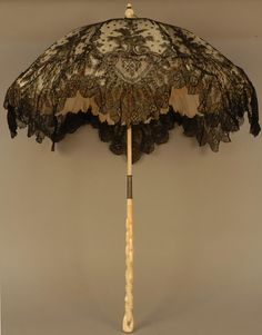 FOLDING CHANTILLY LACE PARASOL CARVED IVORY HANDLE, 1870's.