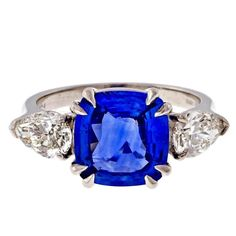 Peter Suchy Sapphire Diamond Platinum Three Stone Engagement Ring  | From a unique collection of vintage engagement rings at https://www.1stdibs.com/jewelry/rings/engagement-rings/