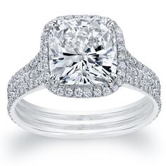 cushion cut halo engagement ring with 3 bands
