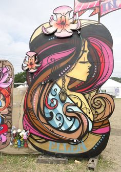 Artist : INKI 3D Wooden Arch damsel for backstage Glastonbury 2013 in loving memory of Amy RIP,