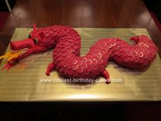 Homemade Chinese Dragon Cake: My 12-year-old daughter and I decorated this Chinese dragon cake for a Chinese New Year's party.  We cut two bundt cakes to form the body. Coated with