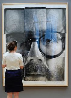 """""""9-Part Self Portrait"""" a collage of large-format Polapan prints by artist Chuck Close is displayed at Sotheby's during a preview of The Polaroid Collection, in New York, June 16, 2010. This image sold for $290,500. (EMMANUEL DUNAND/AFP/Getty Images)"""