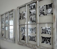 use old window frames and photo corners to create a rotating display of photos. using black  white images creates a cohesive grouping.