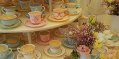 Individual Tea cup Tower | Emily Hankins Cakes. Hand painted edible teacups