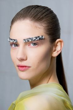 How To Wear It: With confidence! Apply a strip of multi-toned crystals over brows or just stick a tiny gem at the outer corner of eyes for a less outré look. Spotted At: Chanel - HarpersBAZAAR.com