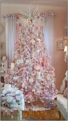 Here are the best Shabby Chic Christmas Decor ideas that& give your room a romatic touch. From Pink Christmas Tree to Shabby Chic Christmas Ornaments etc Shabby Chic Christmas Ornaments, Elegant Christmas Trees, Pink Christmas Decorations, Christmas Tree Themes, Beautiful Christmas, Christmas Villages, Vintage Ornaments, Vintage Santas, Christmas Tables