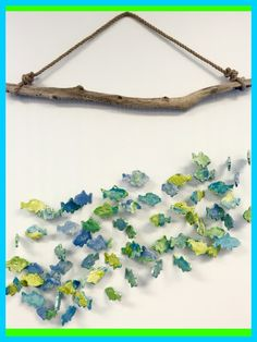 Kindergarten-Clay School of Wind Fish Chime Enjoy the beautiful sound of this unique work of art! Each fish is hand crafted by the children and assembled to form a large 'School of Fish'. This piece is perfect for outside or inside your home.