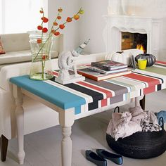 painted stripes in bold colours on a table top.