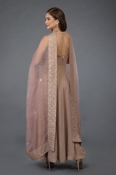 Oyster pink all over gold dot embossed georgette anarkali suit paired with oyster pink gota patti hand embroidered organza silk dupatta and crepe lowers. The organza silk dupatta has exquisite inches wide rose gold gota Indian Gowns, Indian Attire, Pakistani Dresses, Indian Designer Suits, Indian Designer Clothes, Designer Dresses, Neck Designs For Suits, Indian Bridal Outfits, Kurti Designs Party Wear