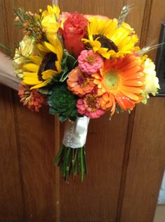 Fresh Fall Bridal Bouquet with succulents, orange Gerberas, sunflowers, zinnias, orange garden roses, yellow garden roses from Flowers by Tammy, Greeneville, TN  423-636-1000