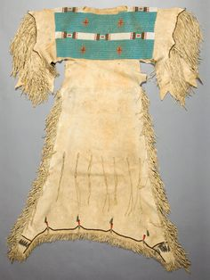 Arapaho Girl's Beaded and Fringed Hide Dress, c. 1890