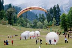 Manali, India: paragliding in Solang Valley.  http://exploretraveler.com/ http://exploretraveler.net