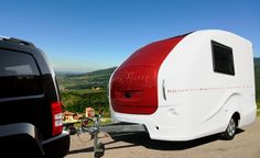 "Wingamm Rookie 3.5 the stylish lightweight caravan with a weight of 750 kg can be towed by anyone. Here in the ""Red and White"" outfit. Made in Italy since 1977."