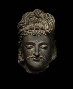 Head of A Bodhisattva  Pakistan; Ancient Gandhara Region 2nd to 3rd century CE, Kushan period stone; Dark gray schist 14 inches (35.5 cm)
