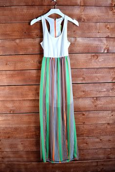 This beautiful and fun maxi dress is lined and zipper back! Also a open lower back! The multi greens with blue, orange and navy goes so well together!   SCUBA BODICE CUTOUT BACK STRIPE PRINT CONTRAST MAXI DRESS WITH SLIT HEMKNIT 95% POLYESTER 5% SPANDEX