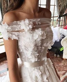 This off the shoulder haute couture wedding gown has beautiful 3d flower art design embellished on the bodice. Have custom #weddingdresses like this made to order in a price range you can afford. We also make realy close #replicas of haute couture #dresses for brides who love the couture style & look but need it for less. Find out pricuing and other details on how it all works when you email us directly from our main website at DariusCordell.com