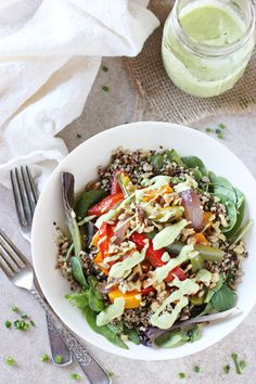 Recipe for rainbow veggie salad. With roasted veggies, quinoa, mixed greens, nuts and an avocado ranch dressing! Perfect for lunch or dinner!