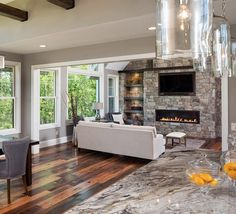 The 2.5 acres of wooded bluff surrounding this home feel a part of the space through the beautiful, bright Integrity windows. Contemporary finishes paired with the densely wooded exterior create an altogether warm ambiance.