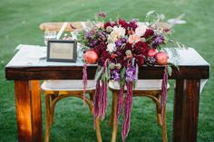 gorgeous pomegranate centerpieces and hanging amaranthus