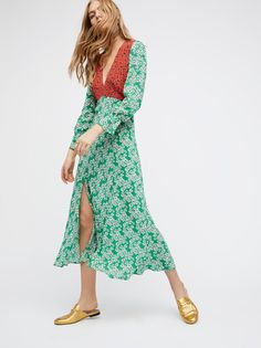 Aoife Maxi Dress | Retro-inspired mixed print maxi dress in a lightweight luxe silk fabric.      * Plunging V-neckline.    * Long sleeves with a flared cuff.     * Hidden back zip closure.    * Statement slip on the skirt.