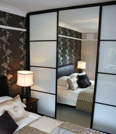 Love this idea good way to split a room and also stylish at that.