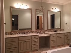double vanity, granite counter tops, custom framed mirrors, and detailed tile.