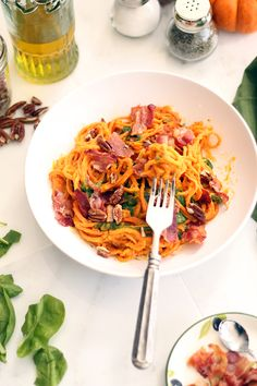 Roasted Butternut Squash Sweet Potato Noodles with Bacon, Crushed Pecans and Spinach - Inspiralized