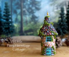 The Little Fairy Hermitage Cottage - Handmade Small Round Sanctuary - French Country House with Tile Roof, Finial, Blooming Flower Box by bewilderandpine on Etsy https://www.etsy.com/listing/231724892/the-little-fairy-hermitage-cottage