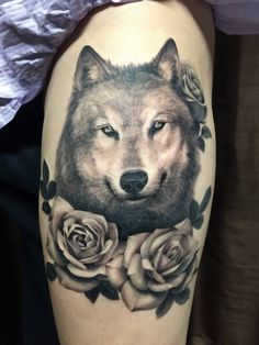 Chronic Ink Tattoo - Toronto Tattoo Wolf and roses tattoo done by Janice.