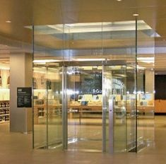 Apple Store Lift, made by 'Apex Lifts.' Completely glass doors cost up to 5 times as much as normal doors so costs could be avoided here.
