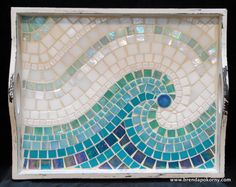 A rustic, white-washed wood serving tray is dressed up with a luscious wave of aqua and teal mosaic. This smallish serving tray measures 14 1/2 x