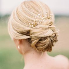 Wedding Updo - A loose, low-slung twisted bun gets an elegant upgrade with a pearly wired embellishment perched atop | DailyMakeover.com