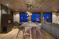 Hafjell - Eksklusiv og eventyrlig tømmerhytte fra 2016 med spektakulær utsikt - Ski inn & ut alpint og langrenn - Meget høy og påkostet standard med moderne og tekniske løsninger - 10 soverom - Dobbel garasje i u etg - Egen leilighet i U.etg. | FINN.no Wooden Cabins, Dining Table, Real Estate, Interior, Decorating, Furniture, Home Decor, Decor, Decoration