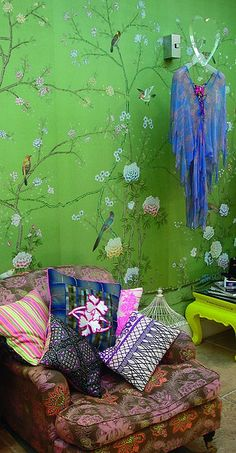 love the green wallpaper and mix of colors