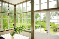 Swedish, sun room, paned windows wrapping room, interesting moldings, view of garden House In The Woods, My House, Victorian Style Bathroom, Stockholm Archipelago, Sweden House, Vintage Cabin, H & M Home, Scandinavian Home, Beautiful Homes