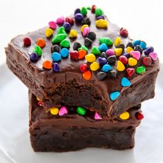 Super fudgy homemade brownies topped with decadent chocolate frosting and rainbow chips!