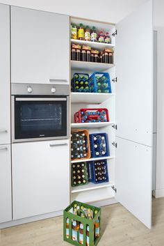Plan kitchen with all-round carefree service at Spitzhüttl Home Company - The slightly different mini bar. In the large drinks cupboard by Contur Küchen, beverage crates ar - Mini Bars, Cupboard Storage, Storage Cabinets, Cabinet Storage, German Kitchen, Kitchen Storage Solutions, Modern Farmhouse Kitchens, Cuisines Design, Kitchen Cupboards