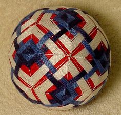 Temari means Handball. A Highly valued gift symbolizing deep friendship and loyalty. Brightly colored threads with the Recipient a Brilliant and Happy Life  Temari is an ancient form of Japanese culture and art, the gift or a Temari ball is believed to bring good fortune to the recipient. This Temari ball is a rice hulls with a bell wrapped with thread and sewn with contemporary and traditional patterns. 3 1/2 inch diameter