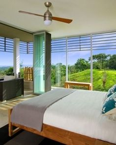 Casa Tierra  ( Nicoya, Costa Rica )  The master bedroom opens up to a balcony with views of the verdant grounds all around. #Jetsetter