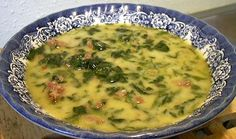 Low Carb Tuscano Soup!   1 pound Italian sausage   1 small onion, diced, 2 1/2 ounces   2 cloves garlic, minced   3 cups chicken broth   10 ounce package frozen chopped spinach, thawed   1/2 cup heavy cream   Salt and pepper, to taste   Freshly grated parmesan cheese, optional