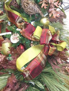 Holiday bow in plaid & green from From the Alpine Escape Theme at Your Christmas Shop at Stauffers of Kissel Hill Garden Centers. (http://www.skh.com/home-garden/departments-2/the-christmas-shop/)