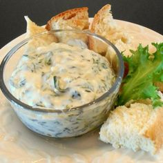 "Artichoke & Spinach Dip Restaurant Style | ""Holy moly! This is the best spinach dip I have eaten or made. I used 8 oz cream cheese, and a jar of alfredo, which was more than 10 oz, and 1 t garlic powder. I softened the cream cheese in the microwave, mixed all in a bowl, moved to shallow dish and baked for 25 min."""