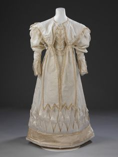 Eliza Larken's wedding dress, 1828. The Pelegrine and long sleeves, suited to the church ceremony, conceal the short puffed sleeves which made the gown adaptable for afternoon/evening celebrations. made from crisp white striped cream silk, figured with small floral sprigs, and trimmed with pale gold and white satin and hand-made blonde silk lace. V&A T.124:1,2-2009