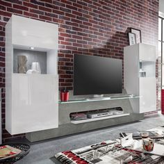 Diese Moderne TV Wand Mit Weiß Glänzenden Fronten Und Betonoptik Ist Die  Ideale Komplettlösung Für