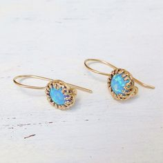 Check out this item in my Etsy shop https://www.etsy.com/il-en/listing/233687403/gold-earrings-opal-earrings-gold-dangle