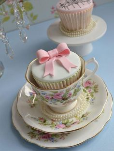 So pretty together! A cupcake served in a Royal Albert 'Moss Rose' teacup.