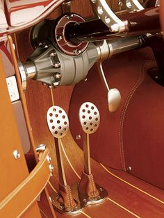 clutch... brake wrapped in leather..wood floor and polished metal pedals..  :-)
